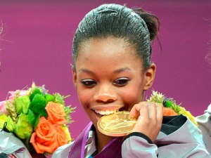Gabby Douglas celebrates with Gold Medal